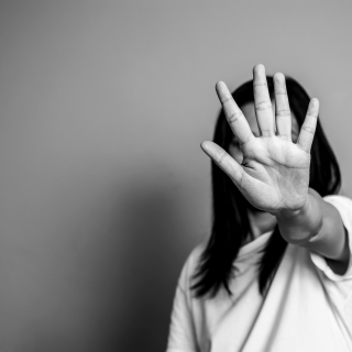 woman raised her hand for dissuade, campaign stop violence again